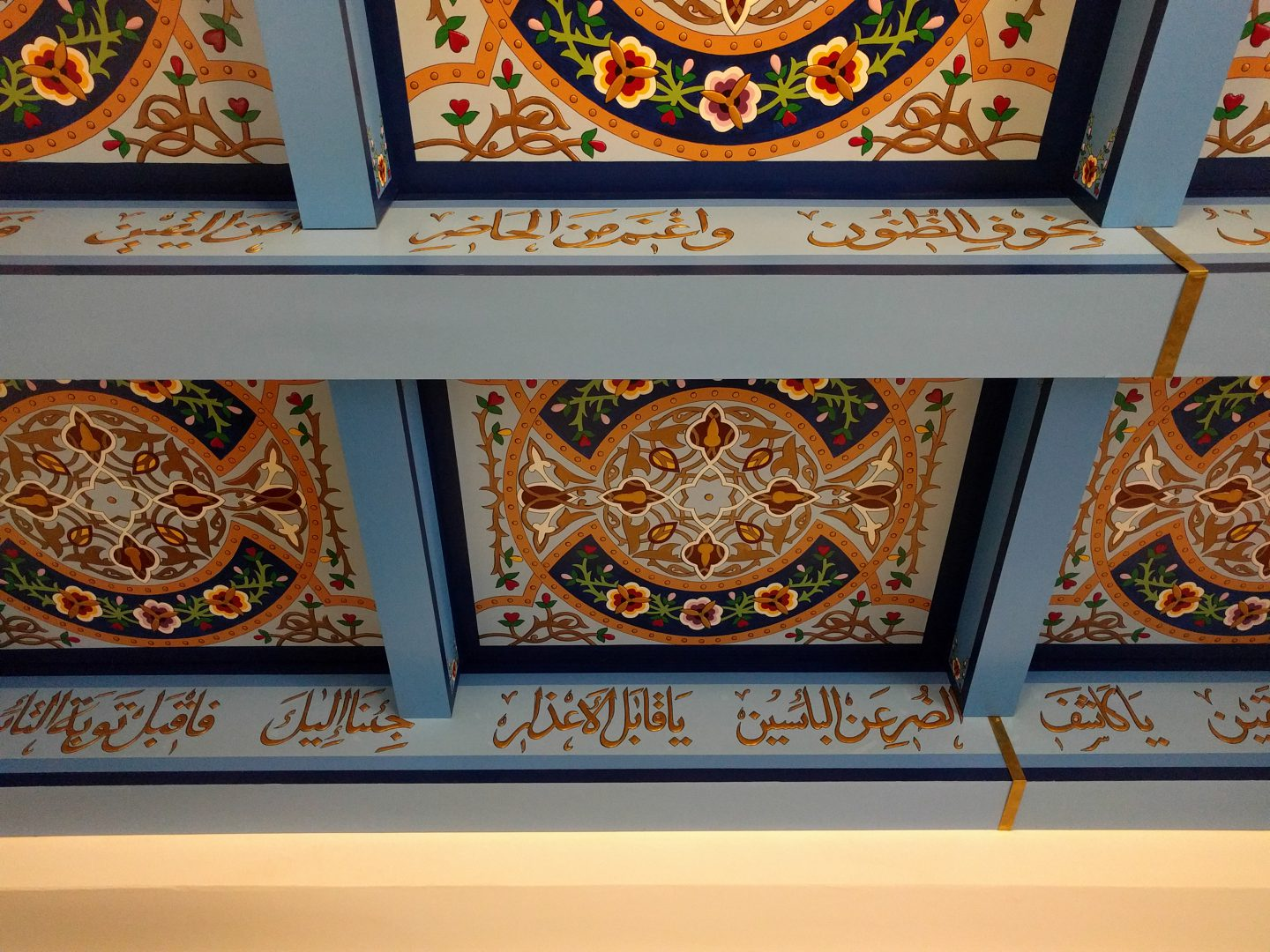 Beautiful hand-painted wood panels on the ceiling